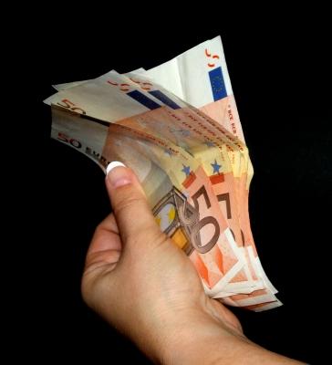 Geld mit vollen Händen