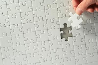 Puzzle mit Hand