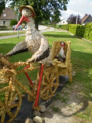 Storch auf dem Fahrrad