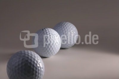 Drei Golfbaelle