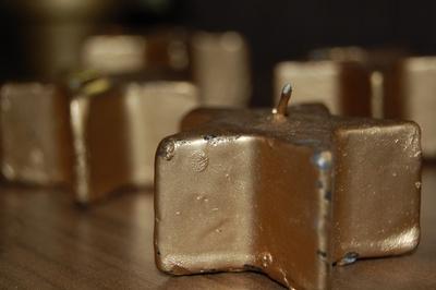 Goldene Sternkerzen