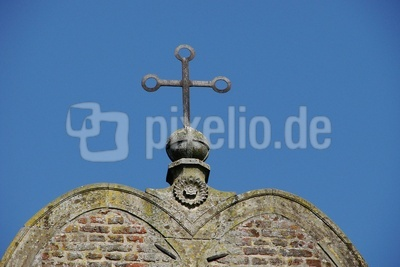 Das Kreuz auf der Weltkugel