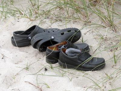 Schuhen im Sand