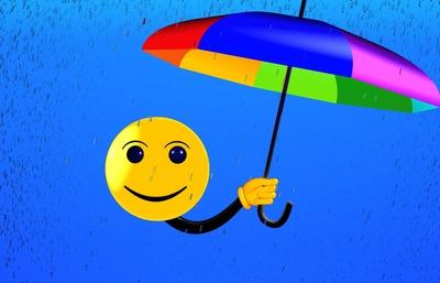 Smiley mit Schirm und Regen