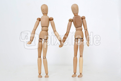 Gliederpuppen halten Händchen