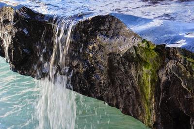 Lichtspiel Wasser und Stein