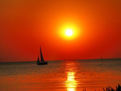 Insel Poel Sonnenuntergang mit Schiff