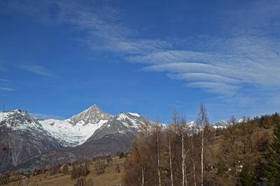Federwolken über den Alpen