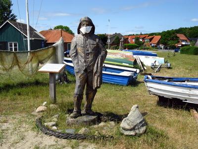 Fischerfigur mit Maske