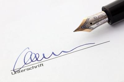 signiert